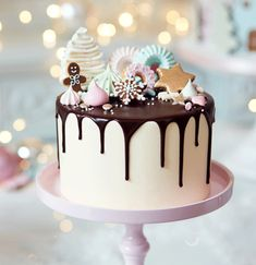 is a Peggy Porschen Christmas Cake! Order yours now and our bakers in Belgravia will have it ready in time for Christmas. Drip Cakes, Bolo Drip Cake, Xmas Food, Christmas Sweets, Christmas Cooking, Pretty Cakes, Cute Cakes, Winter Torte, Peggy Porschen Cakes
