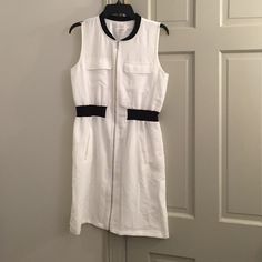 Calvin Klein Dress size S NWOT White w/ Black Trim Gorgeous Clavin Klein dress. Took the tags off and never worn. Just been hanging in my closet. Perfect for work or play! Smoke free home. Calvin Klein Dresses