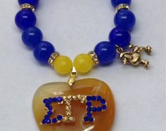 This is Sigma Gamma Rho beaded stretch bracelet
