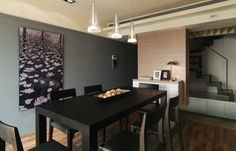 Dining Room Simple Minimalist Dining Room Dark Grey Concrete Wall Ladder Back Neutral Wooden Dining Chair Plaid Wooden Floor Floral Pattern Canvas Decorative Painting Long Black Wood Dining Table Modern Ceiling Lighting Interior Dining Room Design Inspiration With Ceramic Floor