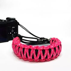 Neon Pink and White Camo DSLR Camera safety strap. Easy to wear, tangle free, super strong, and very light. Want one in your favorite colors, or team colors? Hit me up. Get yours today only at www.stupidstraps.com #stupidstraps #straps #wriststrap #strap #camera #550 #strong #digital #pink #white #pinkandwhite #camo #pinkcamo #dslr #safetystrap #safety #custom #handmade #nikon #madetoorder #canon #sony #photographer #photography #photoshoot #photo #pinkandblack #blackandpink #kingcobra