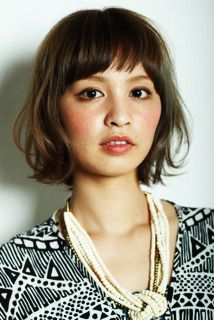soft, layered pageboy bob with bangs