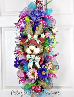 A personal favorite from my Etsy shop https://www.etsy.com/listing/507482701/easter-wreath-swag-bunny-wreath-easter