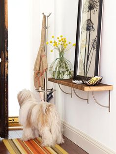 This is the perfect solution for my teeny foyer. I especially like the open metal brackets with the repurposed wood shelf. (From Better Homes & Gardens.)