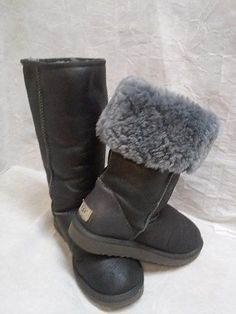 Australia UGG Classic Tall boots Metallic Gray women s size There is a  small puncture hole on the upper part of boot not even noticeable very  small. Fur ... 1bb3fae00b