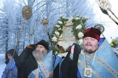 Feb. 22, 2012    A procession of Orthodox believers follows the priests holding the Theotokos of Pochayiv, an icon of the Virgin Mary, after the icon arrived at Manas airport near the Kyrgyz capital Bishkek.  Vladimir Pirogov / Reuters