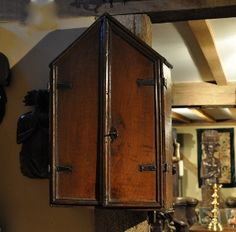 A VERY PRETTY AND RARE CHARLES II OAK MURAL CUPBOARD. -THE GABLE FORM TOP WITH TWO EDGE MOULDED DOORS WITH WONDERFUL IRON HINGES AND LOCK.