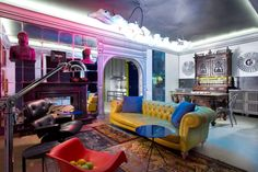 The artistic palette of interests in this eclectic studio apartment in Kiev is reflected in bold colors, iconic designs and unconventional furnishings.