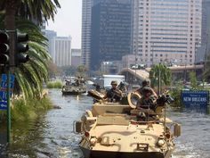 National Guardsmen navigate through the flooded city of New Orleans