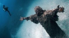 An underwater statue of Jesus sits at the bottom of the sea off the coast of Malta, near Sicily, Italy. After being blessed by Pope John Paul II, it was placed underwater as an attraction for divers.