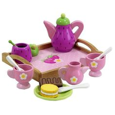 This colorfully painted strawberry themed tea set is adorable and perfect for having tea with friends. Features a serving tray, tea pot, 2 tea cups, 2 tea spoons, a sugar dish, creamer, as well as som