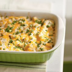 These lightened cheesy chicken enchiladas have a creamy cheese topping in place of a more traditional enchilada sauce.