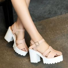 - Unique open style platform sandals for the fashionable woman - Great for casual outings or social events - Ankle strap offers style and support - Made from microfiber leather - 8 cm heel height - 4