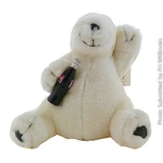 As only Coke can do it a Coca Cola Polar Bear Plush Play by Play circa 1996. Complete with tush tag and tag on arm. Bear holds a miniature Coca-Cola bottle in his paw. Adorable. /$35.95