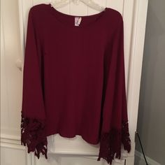 Red crochet bell sleeve top Never worn. Bell sleeves with crochet cuffs. Tulip back. Non sheer chiffon. Francesca's Collections Tops Blouses