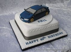 Subaru Cake. Square celebration cake topped with modelled Subaru car -- hmmm not a bad idea for my dad's birthday