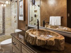 Renovated Ninth Floor Beach Condo for Sale in Park Plaza. Sink made of petrified…