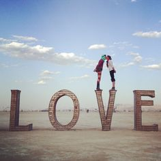 Kissing on LOVE - 30 Amazing Photos That Will Make You Wish You Were At Burning Man 2014