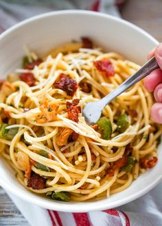 Rich and decadent meets quick, cheap, and easy in this creamy Spaghetti Carbonara. I have a controversial opinion, I think spaghetti carbonara is like the fried rice of Italian food. It's cheap and filling. It's super quick and easy. And it just takes a handful of ingredients to make it amazing. Today I'm sharing one of my favorite versions of this classic pasta dish. It's not a traditional spaghetti carbonara, but it is tasty and more importantly, it has easily accessible ingredients!