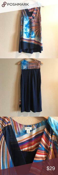 "ANTHROPOLOGIE TINY Sleeveless Tank Top - Small Worn only twice! Small pull in fabric on the front (see picture). Polyester print front and solid navy blue Rayon/Cotton back. Great on its own or layer with a pair of jeans or capris, lands mid- to upper thigh on 5'4"" person. Anthropologie Tops Tank Tops"