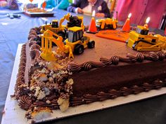 Construction Cake.  This cake looks like a regular frosted cake but there are machines on it that are breaking it up.  In other words the frosting doesn't look like dirt.