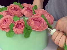 Learn how to pipe peonies and arrange them in a...