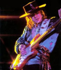 "Stevie Ray Vaughn: For the most part I'm not a big fan of the blues or even ""bluesy"" guitar work. But SRV was unique. No matter what he played, I enjoy it.  He had charisma and taste and it showed in his playing and writing.  When you couple that with the fact that he played with very heavy strings it only adds to the magnitude of his musical legend."
