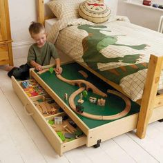 Dinosaurs and trains! What more could a child want? Well, a place to play in tight spaces would be nice! So this under the bed train table is a great idea!