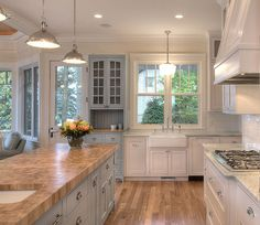Kitchen cabinet paint colors: santorini blue and simply white (B. Moore); walls: antique white (S. Wms.)