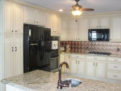 Inviting Ivory Cabinets with Copper Backsplash [Copper River Cabinet Company]