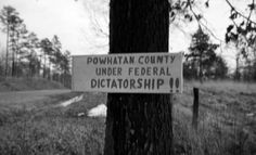 "Sign (""Dictatorship"") on tree, Powhatan County, Va., 1962-1963 :: Edward H. Peeples Prince Edward County (Va.) Public Schools - Date of Photograph	 1962-1963 - Sign on tree on U.S. route 60 in Powhatan County, Va., on south side of highway about two miles from Cumberland County line. It followed an order by Federal District Judge John Butzner to admit six African Americans to two Powhatan County Public Schools & also enjoining county officials from closing schools to avoid desegregation."