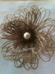 twine loopy flower with rusted nut and pearl center