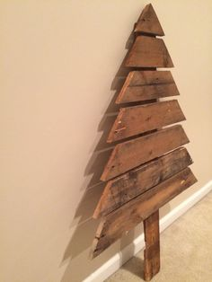 This Christmas Tree is a perfect addition to your Christmas decor! Made from pallet wood and hand painted green. Embellished with silver and red