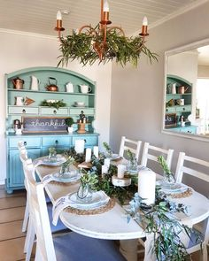 One of my favourite tablescapes - mixing fynbos and eucalyptus to create this simple table. Of course I love my blue hutch in the background along with the fun pops of copper from the chandelier and kettles ❤ Dining Room Hutch, Kettles, Rustic Christmas, Tablescapes, Table Settings, Room Ideas, Copper, Chandelier, Decorating