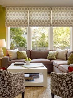 Patterned Roman shades mounted outside window & higher, making windows look taller and ceiling higher - how I want LA to look
