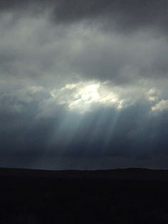 Break in the storm clouds on a wet and cold morning on a quiet back road in the Karoo