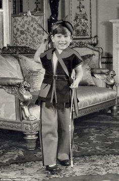 Prince Charles, aged 5, dressed as Robin Hood, 1953. Photo taken in Buckingham Palace.