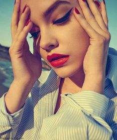 Gorgeous Barbara Palvin with red lips and bold eyeliner makeup look