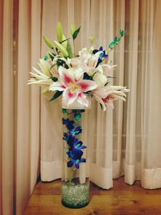 Alter piece from our first 2013 wedding.  Peacock orchids and stargazer lilies
