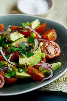 Guacamole Salad  Serves: 4-6    4 avocados, thinly sliced  2 cups cherry tomatoes, halved  1 red onion, thinly sliced  large handful fresh parsley  for the dressing  juice of 1 lemon  2 tablespoons olive oil  salt & pepper to taste (I used fresh white pepper)  Instructions  Place the sliced avocado, cherry tomatoes and red onion on a large platter/individual plates and scatter over the herbs and chilli.  Mix all the dressing ingredients and pour over the salad.  Serve immediately