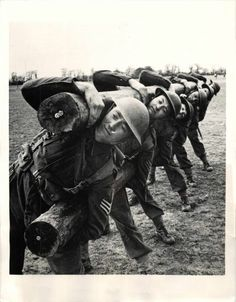 "1942- Soldiers exercise with heavy logs during British army's new ""every man a Commando"" training program."