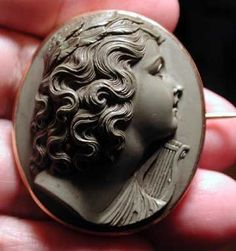 The best museum quality lava Terpsichore cameo ever in 18 kt gold