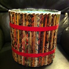 This is a vintage 1950 waste paper basket created from rolled pages from a magazine glued to the form. Mine is still used and has  that well worn look. Could be a fun project.