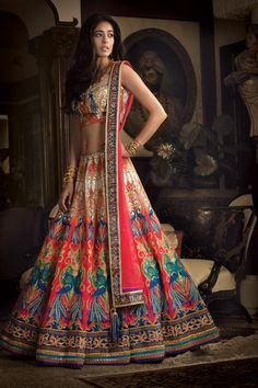 Love the colors! Digital printed silk lehenga and blouse with net dupatta embellished with zari and stone