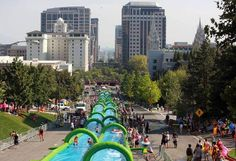 There's nothing as exhilarating as flying through downtown Salt Lake on a waterslide - especially one that's as long as three football fields!