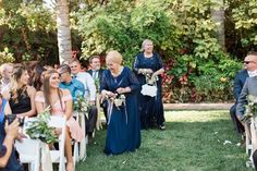Adorable flower girl outfit idea - bride + groom's grandmothers served as the flower girls in navy, floor-length dresses {Lucas Rossi Photography}