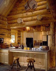 Sweet Country Life ~ Simple Pleasures ~ The interior of this cabin keeps things as authentic as possible, with even the kitchen stools matching the theme of the room.