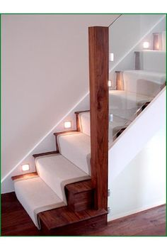 Walnut and glass staircase with clever use of lighting at skirting level - love…