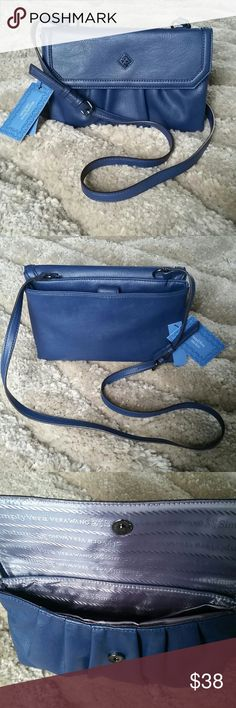 """Beautiful Simply Vera Pleated Crossbody Bag Get in style with this beautiful satchel from Simply Vera Vera Wang. The pleated design give this crossbody bag fashion from any angle. Features: adjustable crossbody strap, magnetic snap slip pocket, interior zip pocket, approx. drop down length 23"""". Size: 6.75""""H/ 10.5""""W/2.5""""D. Faux Leather. Simply Vera Vera Wang Bags Crossbody Bags"""