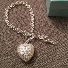 Puffy Heart Bracelet Two sided Puffy Heart Bracelet  measures 7 1/2 inches long. Has an adorable heart key toggle closure. Brand New. Only took from ziplock bag for pics Unknown Jewelry Bracelets